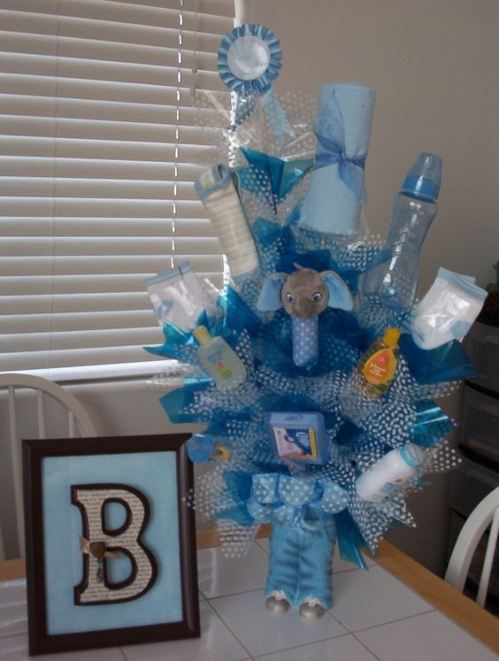 You Re Throwing A Baby Shower And Mom To Be Is Having Boy There Are Blue Decorations On The Cake Or Cupcakes Clothes