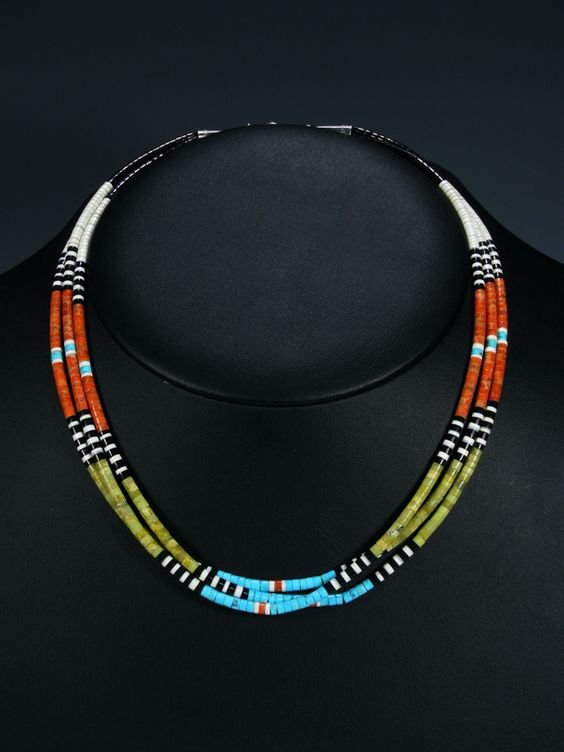 "ative American Indian Jewelry Santo Domingo Necklace   Stones: Jet, Apple Coral, Shell, Serpentine, and Turquoise  Size: 18"" in total length  Suggested Retail $175.00 / Your Price: $138.00"
