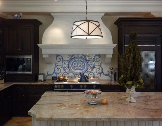 Smitten with this elegant traditional kitchen design with New Ravenna Acanthus blue and white mosaic on backsplash.
