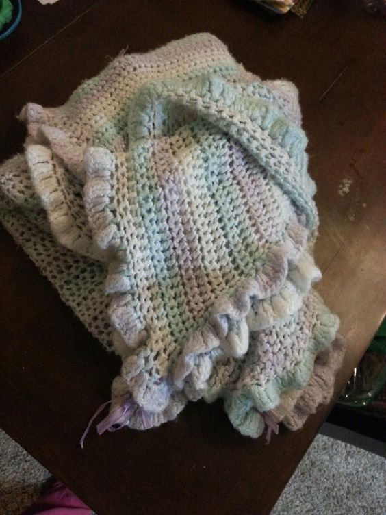 This is a baby blanket I made 3 years ago for my granddaughter Olivia.