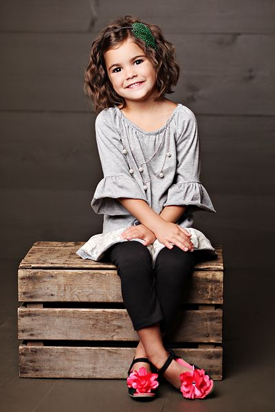simple crate prop & chocolate flooring and walls...love the pop of color from her shoes!  Precious!