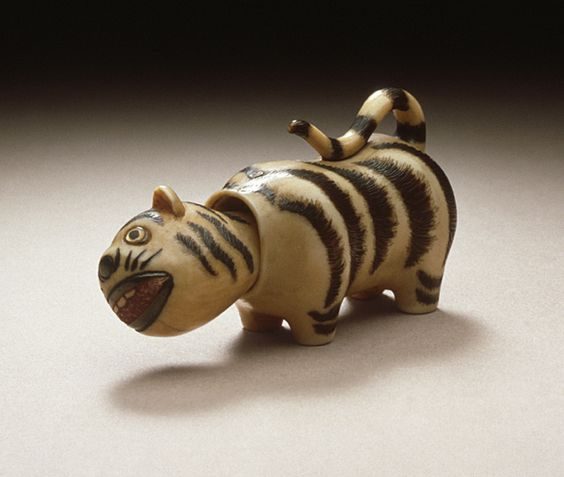 Hoichi (Japan, 1829 - 1879)   Tiger Doll, mid- to late 19th century  Netsuke, Bone with staining, sumi, red pigment, double inlays