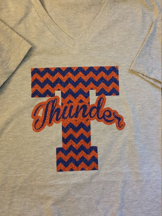 This listing is for Ladies relaxed fit Vneck Tee  This is a Large 2 color chevron Glitter Letter with your choice of colors and a Team name or mascot name listed across the Large Letter in a curve cursive font. Letter size is about 8 inches Tall and 6-7 wide  Please provide the following when ordering: Chevron Letter: Chevron colors: (choose 2) mascot or team name: (color)  any additional information  Send convo with questions.