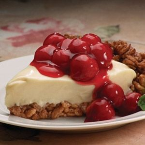 Encased in a crispy, pat-in-the-pan, chocolate crust, this no-bake cheesecake takes just minutes to prepare. The cherry pie filling spooned on top makes it look regal.