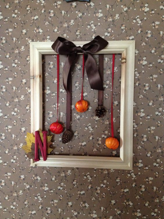DIY autumn frame wreath with pumpkins, leaves, initial, and pinecones!
