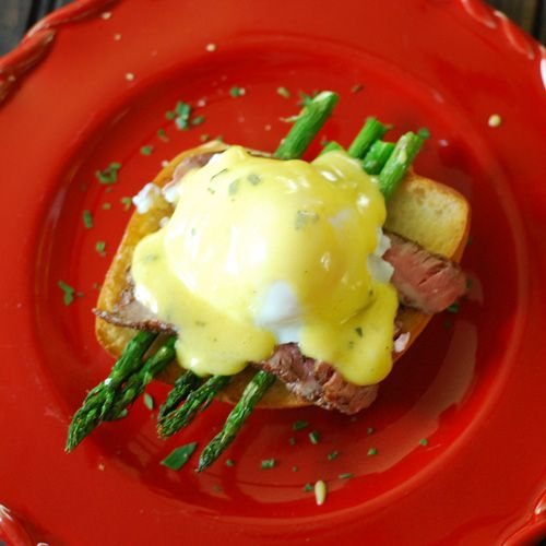 Steak and eggs Benedict - toasted yeast roll, roasted asparagus ...
