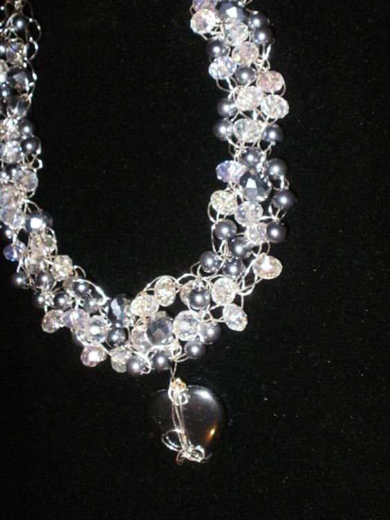 Silver beads, crystal beads, silver pearls, and crocheted wiring.