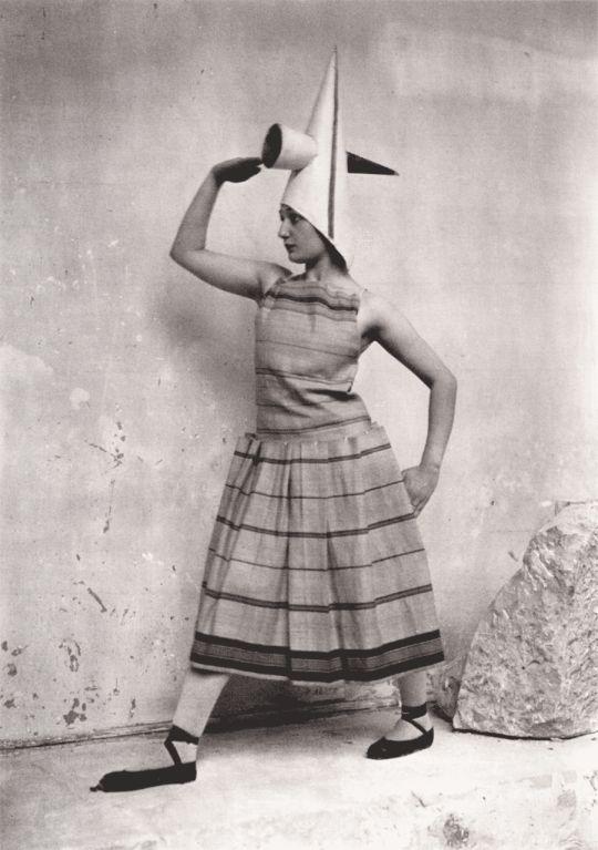 Lizica Codreano studies in costumes designed by Constantin Brancusi.  Photo taken by the sculptor in his studio, Paris, 1924