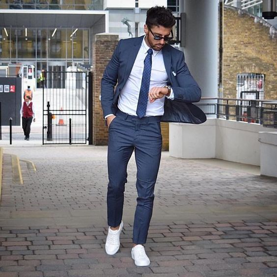 suit and sneakers