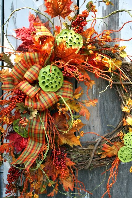 festive fall wreath.... The painted lily pods make this wreath design pop.  Love it!  lr: