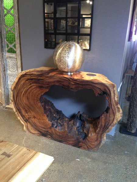 This hunk of wood has been left as natural as possible to show the beauty of the tree while acting as a console table.
