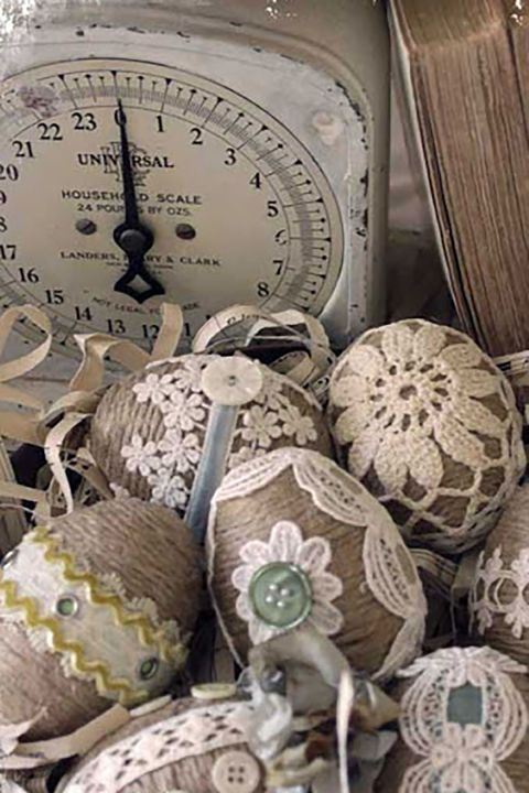 Twine and Lace Easter Eggs:  Wrap your eggs with twine and embellish them with lace, buttons, and ribbon for a vintage look.: