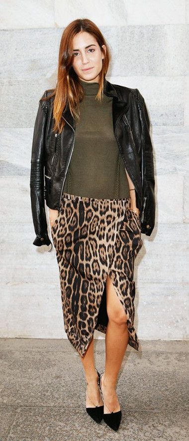 Leopard high-slit skirt worn with olive green turtleneck and black moto jacket: