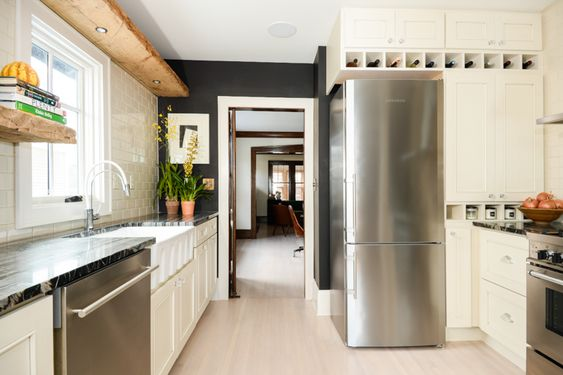 black walls with white cabinets in bungalow galley kitchen