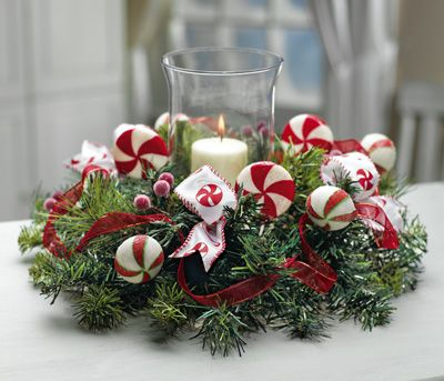 Candle rings centerpieces and candles on pinterest for Candy cane holder candle centerpiece