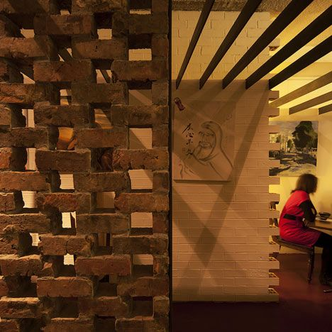 A Screen Made From Century Old Bricks Divides This