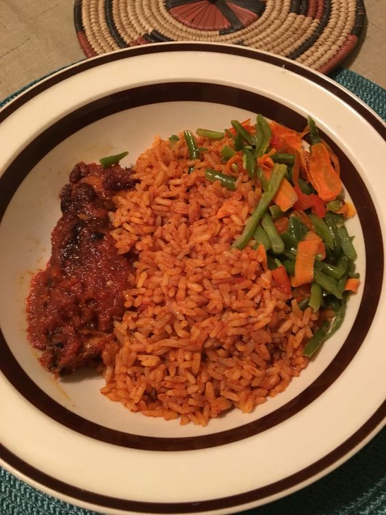 Jollof rice, stewed veggies and peppered fish. Food is joy!