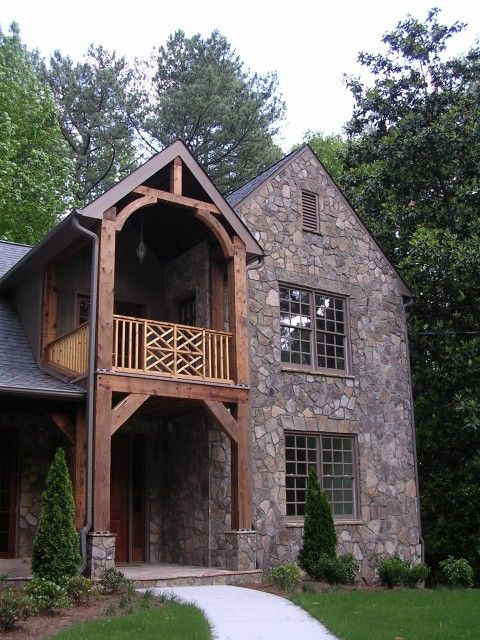 The use of field stone and wood beams gives this home s for Rustic french country exterior