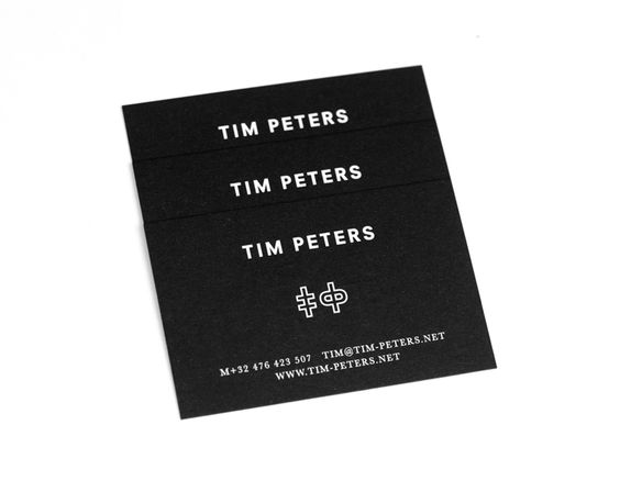 Tim Peters Business Card Business card printed on 700gr black paper, with white hot foil and embossing finishing.