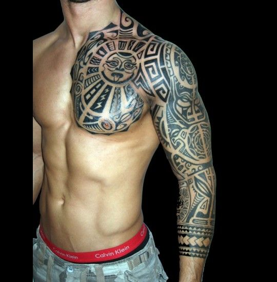 Google Image Result for http://tattoomodel.besttattooart.net/wp-content/uploads/2011/04/27_tribal-rock-styled-tattoo-on-arm-and-chest_540x550.jpg