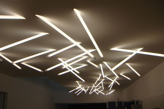 Some great lighting design possibilities here: The Polycarb Stick Light is a T5 fluorescent light fixture consisting primarily of an illuminated tube that penetrates a ceiling cavity at an angle. The light fitting is installed into a trimless housing that is permanently plastered into the ceiling cavity via @plastolux