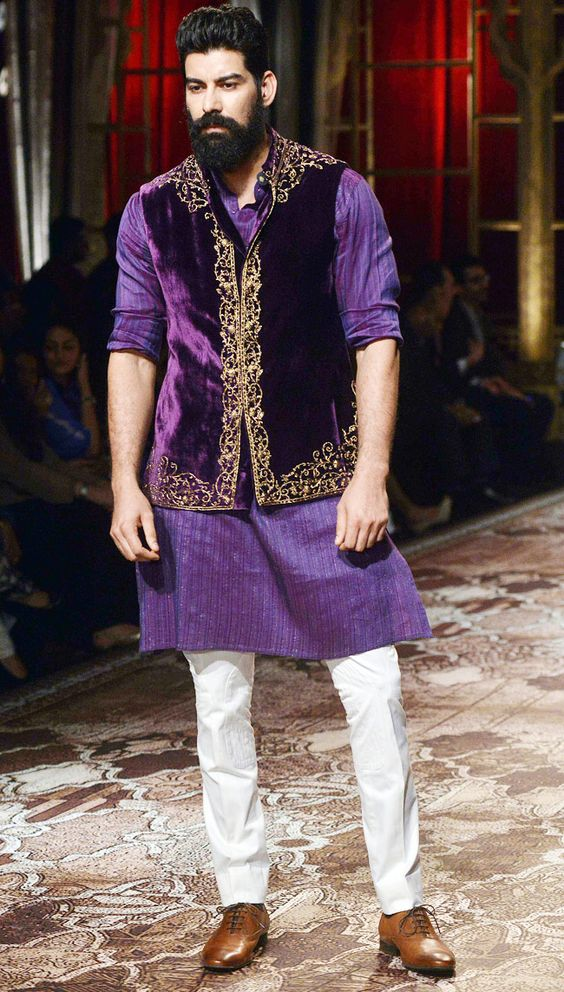 Model walking on the ramp for Raghavendra Rathore on the second day of the sixth edition of the BMW India Bridal Week | Indian Groom Wear Ideas | Pantone colour of 2018 | Function Mania | 7 NEW Looks for Grooms of 2018 Inspired by Pantone Colour of the Year!