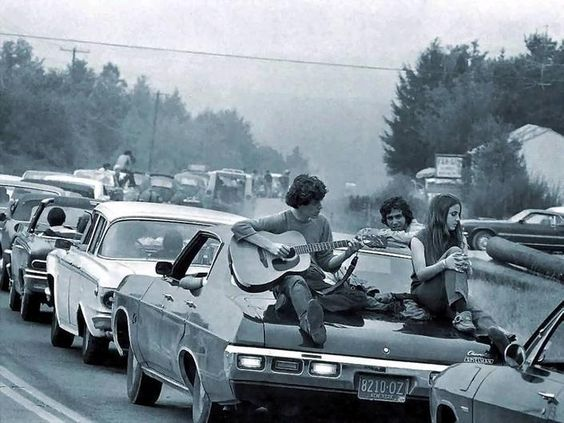 We're goin'' up country, gotta get away. Traffic going to Woodstock: