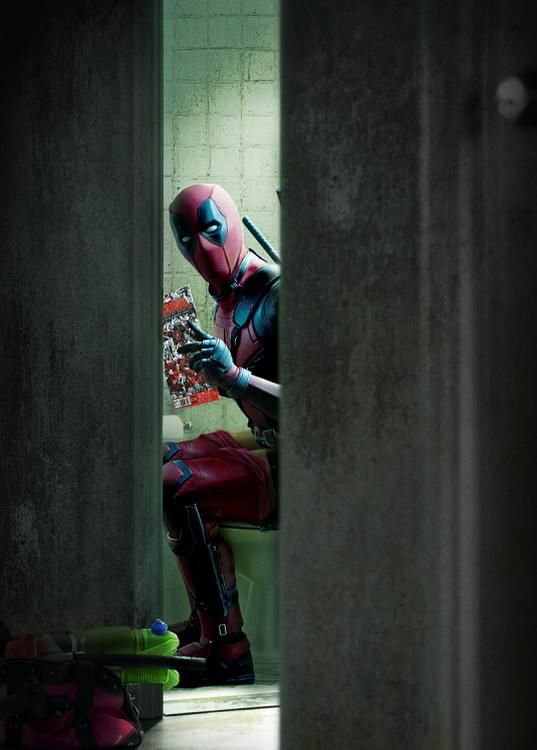 """Ryan Reynolds has unveiled a new hilarious official photo of himself as Deadpool taking a crap while reading Deadpool #250, which is the most recent comic released for the character."""