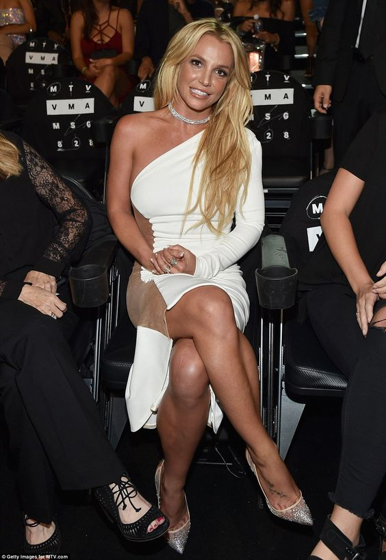 Ready for the show: Britney wowed in white as she sat down to watch the show