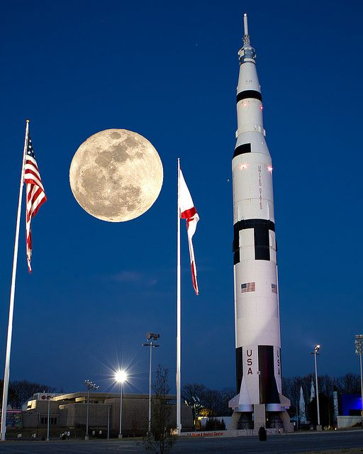 U.S. and Alabama flags fly with the Moon and a rocket, at the U.S. Space and Rocket Center in Huntsville, Alabama. Photo by Jerry Slaughter, via Pinterest