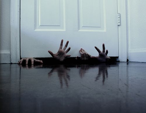Stick Dollar Tree hands under the door - creepy: