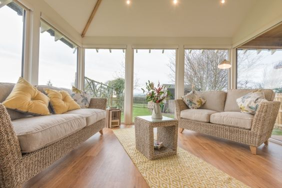 Open plan lounge with full length windows