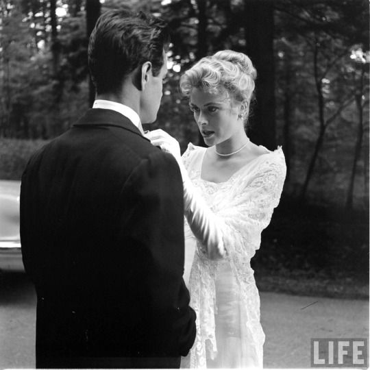 Grace Kelly and Louis Jourdan between takes on the set of 'The Swan' (Charles Vidor, 1956) by Peter Stackpole.: