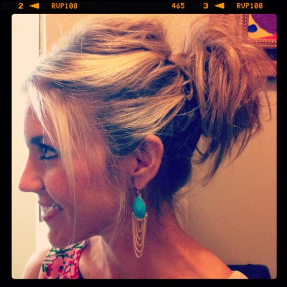 Simple knotted ponytail. Love that it's messy!