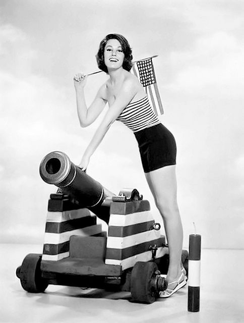 Paula Prentess is ready to light the cannon for her 1962 Forth of July