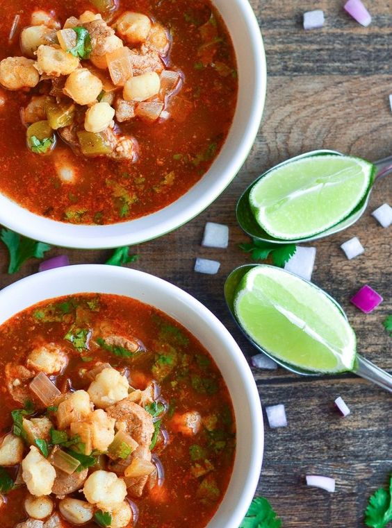 Ridiculously easy, inexpensive Mexican pozole (posole) recipe that is sure to impress with pork, hominy, green chilies, and a twist of lime.