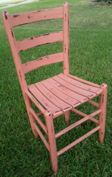 Rustic salmon  colored ladder back chair.