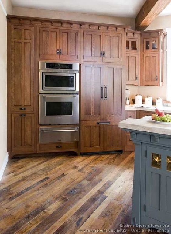 Mission Style Kitchen Cabinets. Love the cabinet style and different finish colors.