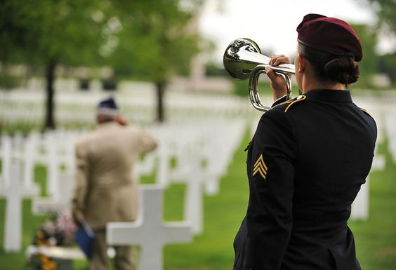 Leslie Cruise, a World War II veteran, salutes the grave of Pvt. Richard Vargas while Army Sgt. Jeannette Mason, 5th Quartermaster Theater Aerial Delivery Company parachute rigger, plays taps during a wreath laying ceremony at Lorraine American National Cemetery and Memorial, St. Avold, France #USAF