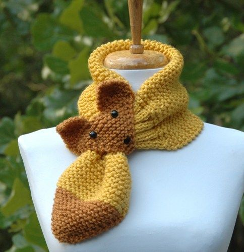 Sly like a Fox? This hand knit keyhole scarf is guaranteed to stay in place. Simply slip the tail through the head loop! Knit in garter stitch and ribbing so there is plenty of comfortable stretch to
