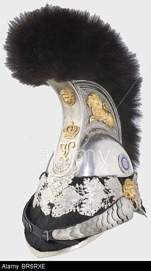 A Bavarian model 1832 helmet for cuirassier officers., Polished, silvered two-piece steel skull. A silver-plated comb bearing a a gilt li Stock Photo