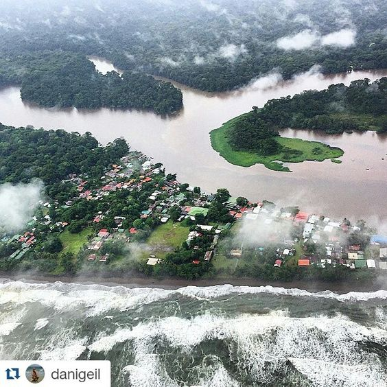 #Tortuguero #town from the air, under the #rain and with some #clouds. Amazing view of some #flooded areas due to the heavy #rainstorms, as well as the #Tortuguero #Canal System and the Stringel #tides and #waves from the #Atlantic #Ocean on the front.  Photo credits: @danigeil