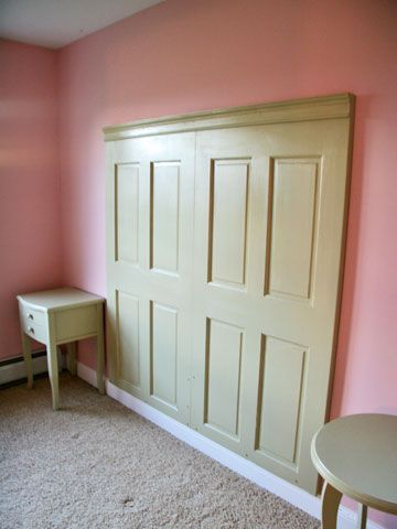 Easy Headboard- 2 doors from Lowes (22.00 each), trimmed, painted and topped with crown molding.
