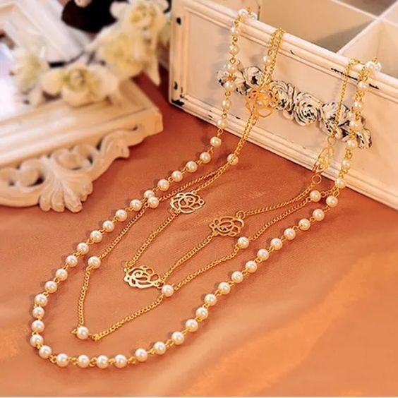 Multilayer necklace Brand new pearl statement. Gold toned, alloy material. It comes with a gift bag. Jewelry Necklaces