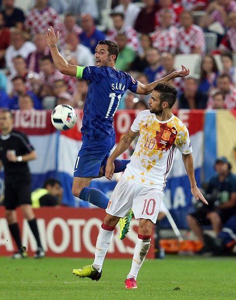 #EURO2016 Darijo Srna of Croatia vies with Cesc Fabregas of Spain during the UEFA EURO 2016 Group D match between Croatia and Spain at Stade de Bordeaux in...