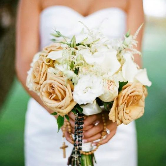 Wedding flowers with draped rosaries