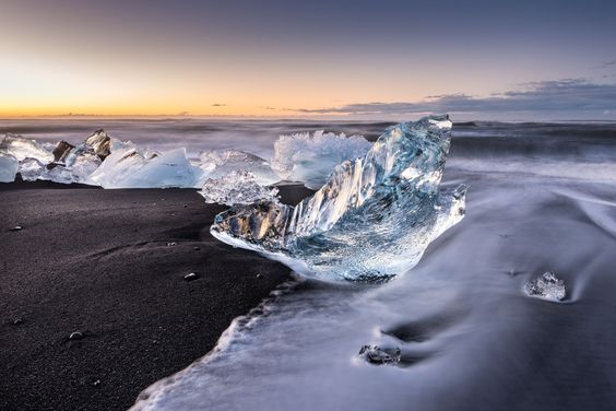 Picture of a chunk of iceon a black-sand beach in Iceland Black and Blue PHOTOGRAPH BY MAHA COMIANOS, YOUR SHOT