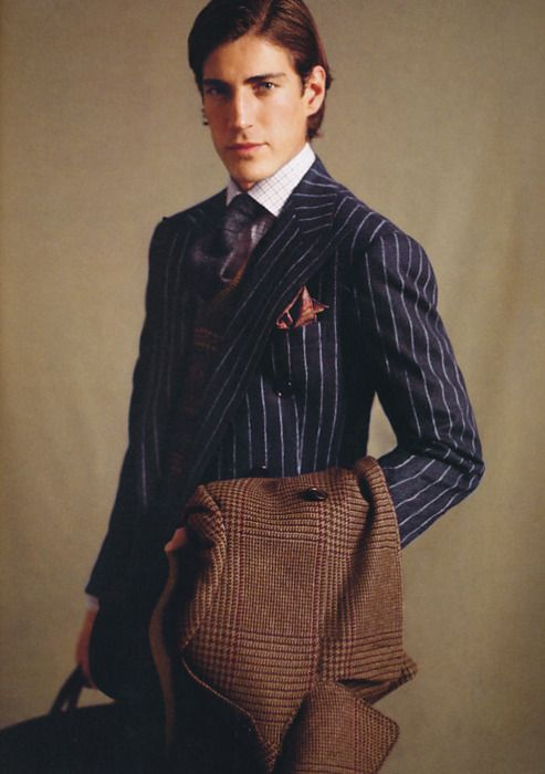 dark blue chalk striped suit, brown checked overcoat