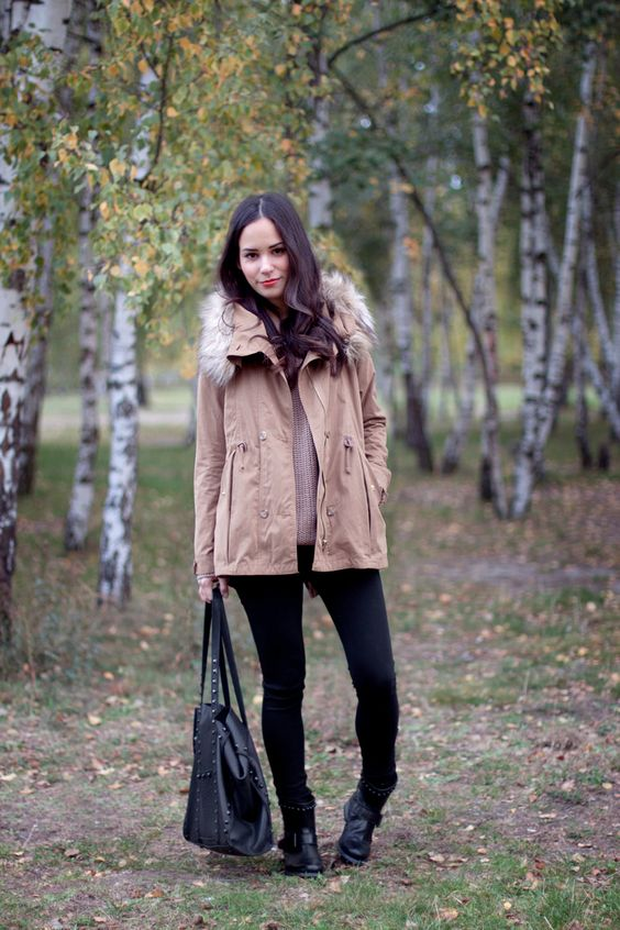 Nisi is wearing a beige parka with faux fur, studded biker boots and a studded bag - teetharejade.com