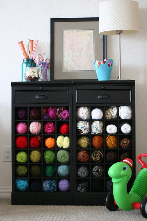 Organize yarn with a wine rack/cabinet.  Saw this idea and thought it was perfect.  If you have an old wine cabinet, find one on sale or can make a few adjustments to dressers...go for it!